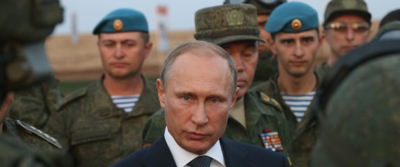 Russian President Vladimir Putin talks to officers as he is visiting the Center -2015 Military Drills at Donguzsky Range in Orenburg, Russia, September,19,2015, Source: www.stopfake.com